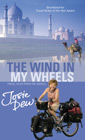 The book cover for THE WIND IN MY WHEELS: Travel Tales from the Saddle. Click to buy.